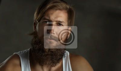 Obraz Portrait of a young stylish bearded man