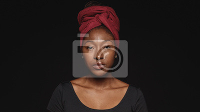 Obraz Portrait of an african woman in a headwrap