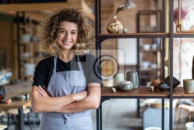 Obraz Portrait of woman pottery artist in art studio