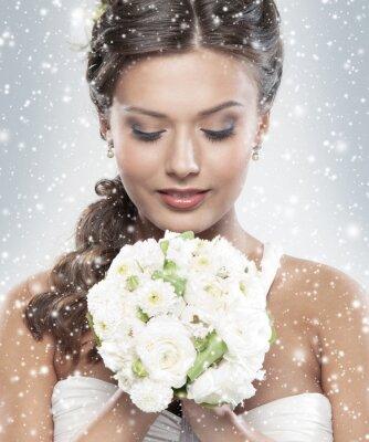Obraz Portret panny młodej trzyma bukiet kwiatów