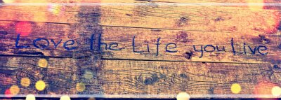 Obraz Positive inspiring quote written carved  in wood Love the life you live. Best motivational quotes, inspirational quotes and sayings about life. Motivation, and inspiration image quote
