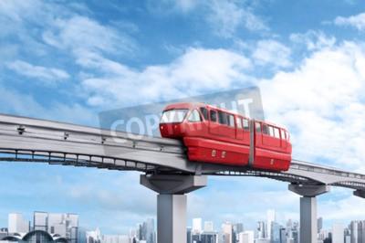 Obraz Red jednotorowe pociągu przeciw błękitne niebo i nowoczesne miasta w tle