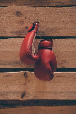 Obraz Rękawice bokserskie na ścianie.