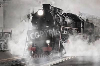 Obraz Retro steam train departs from the railway station
