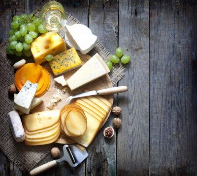Obraz Różne rodzaje sera z pustym tle koncepcji przestrzeni