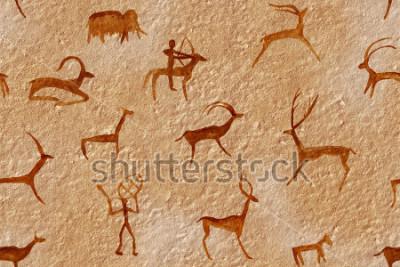 Obraz Rysować bezszwowy w jamie malującej antycznym mężczyzna na ścianie, skała. Maluje czerwoną pomarańczową ochrę. Polowanie na zwierzę. Szaman, rdzenny, neandertalczyk, sarna, baran, statek, mamut, jeleń
