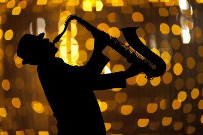 Obraz Saksofonista. Człowiek gra na saksofonie
