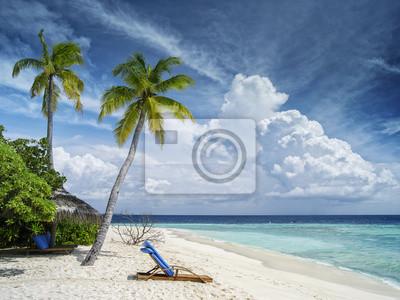 salon-krzesło i Złote Palmy na plaży