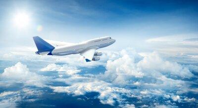 Obraz Samolot latający nad chmurami