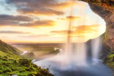 Seljalandsfoss waterfall at sunset, Iceland, Europe.