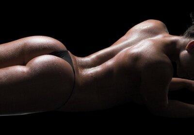 Obraz Sexy ciało kobiety, mokra skóra, czarne tło