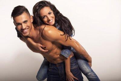 Obraz sexy piękna para w dżinsach