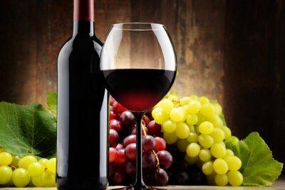 Obraz Skład ze szkła, butelka czerwonego wina i świeżych winogron