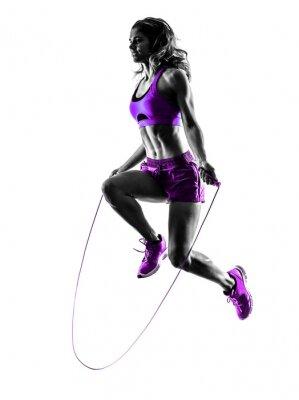 Obraz Skoki kobieta fitness ćwiczenia linowe sylwetka