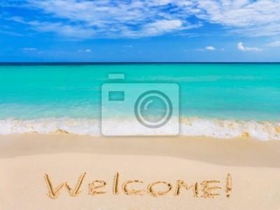 Słowo Witamy na plaży