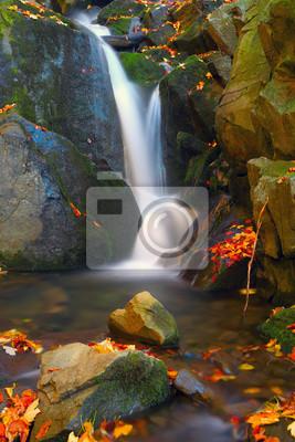 small waterfall on mountain brook
