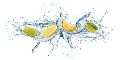 Obraz splashing of water waves with lemon slices, isolated on white