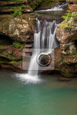 Spring Splash - A beautiful Ohio waterfall, the Upper Falls at Old Man's Cave in Hocking Hills State Park, splashes down a colorful sandstone cliff after spring rains.