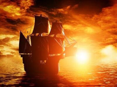 Obraz Starożytny statek piracki rejs na ocean na zachód słońca