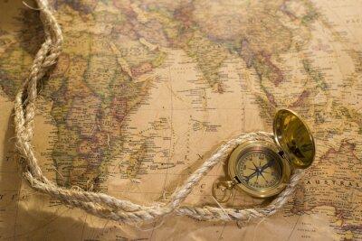Obraz stary kompas i liny na mapie rocznika