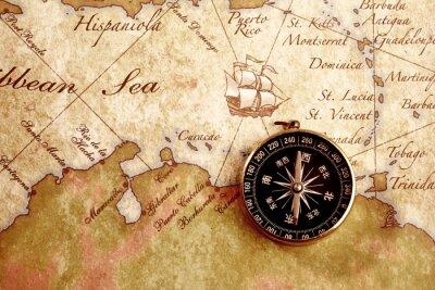 Obraz Stary kompas na tle mapy skarbów