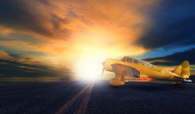 Obraz stary żółty śmigłowy samolot na pasie startowym lotniska z nieba słońca bac