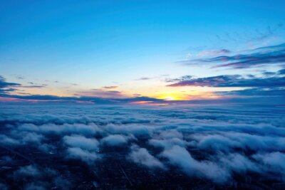 Obraz sunrise on blue sky. Blue sky with some clouds