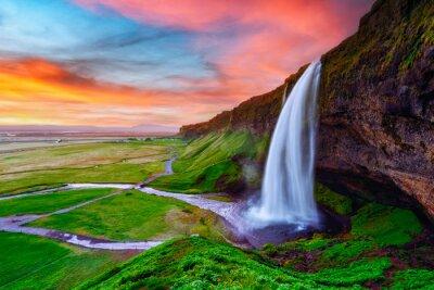 Obraz Sunrise on Seljalandfoss waterfall on Seljalandsa river, Iceland, Europe. Amazing view from inside. Landscape photography