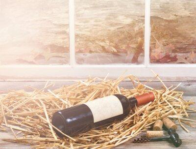 Obraz Światło Okno na butelce wina spoczywała w słomie