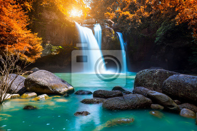 Obraz The amazing colorful waterfall in autumn forest blue water and colorful rain forest.