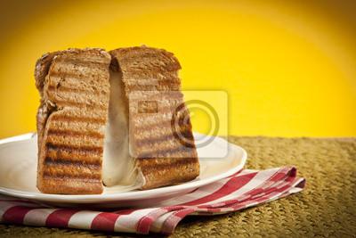 Obraz Tosty z serem z serem topnienia sączące się.