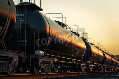 Obraz Transport cysterny z olejem podczas zachodu słońca.