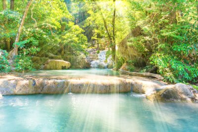 Obraz Tropical landscape with beautiful cascades of waterfall and green trees in wild jungle forest. Erawan National park, Kanchanaburi, Thailand