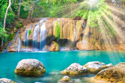 Tropical landscape with beautiful waterfall, emerald lake and green tree in wild jungle forest. Erawan National park, Kanchanaburi, Thailand
