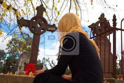 Ukrytych kwiat na grobie Kobieta miejsc