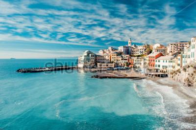 Obraz View of Bogliasco. Bogliasco is a ancient fishing village in Italy, Genoa, Liguria. Mediterranean Sea, sandy beach and architecture of Bogliasco town. Cloudy blue sky sunny day idyllic scenery, winter