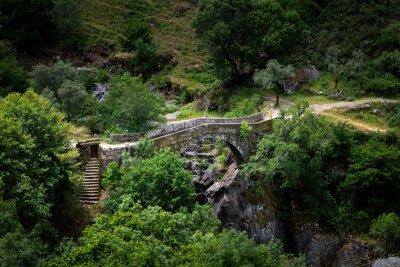 View of the ancient Mizarela Bridge (or Devil's Bridge) at the Peneda Geres National Park, in Portugal, Europe