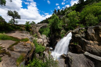 View of the Mizarela Bridge with a waterfall at the Peneda Geres National Park in Portugal