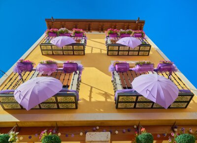 Obraz View of the typical decoration of a house during the july lavender festival in the medieval town of Brihuega, Guadalajara, Alcarria, Castilla la Mancha, Spain.