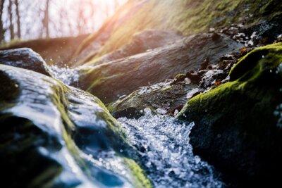 Obraz water flowing over rocks