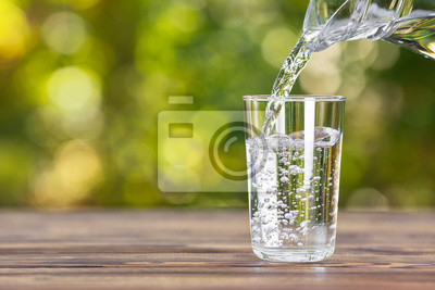Obraz water pouring into glass
