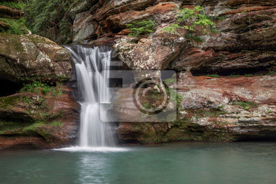Waterfall in the Gorge - A cascading, terraced waterfall spills over colorful sandstone at the head of the gorge at Old Man's Cave in the Ohio's Hocking Hills State Park.