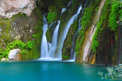 waterfall on green stones
