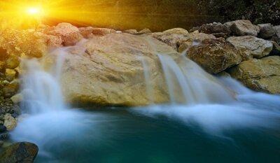 waterfall on sunset background