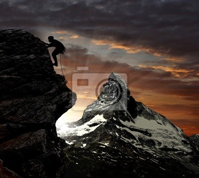 wspinacz w szwajcarskich Alpach