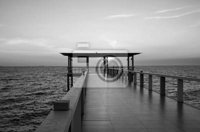 Obraz Black and white Landscape of bridge in sea on tropical beachand sunset sky background .
