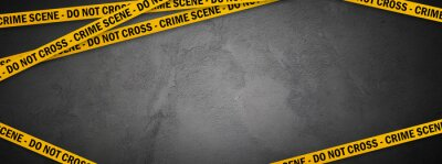 Obraz Yellow police line - do not cross on concrete wall background with copy space. Crime scene dark banner for true crime stories or investigations podcast.