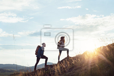 Obraz Young tourist couple travellers with backpacks hiking in nature.