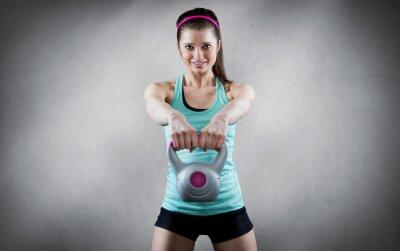 Obraz Young woman kettlebell workout