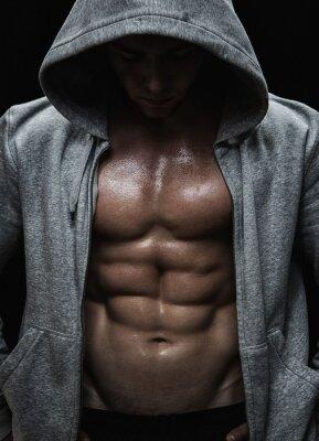 Obraz Zamknij się z mięśni człowieka ciężarów po treningu sportowego